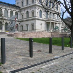 Static design bollards in painted steel and automatic bollard
